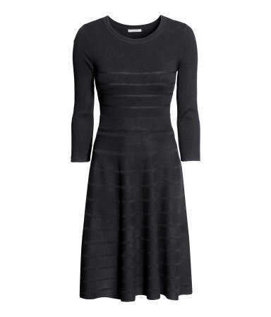 Dress In A Textured Knit - neckline: round neck; pattern: plain; predominant colour: black; occasions: evening, work, occasion, creative work; length: just above the knee; fit: fitted at waist & bust; style: fit & flare; sleeve length: 3/4 length; sleeve style: standard; texture group: knits/crochet; pattern type: knitted - fine stitch; fibres: viscose/rayon - mix; trends: minimal sleek; season: a/w 2014