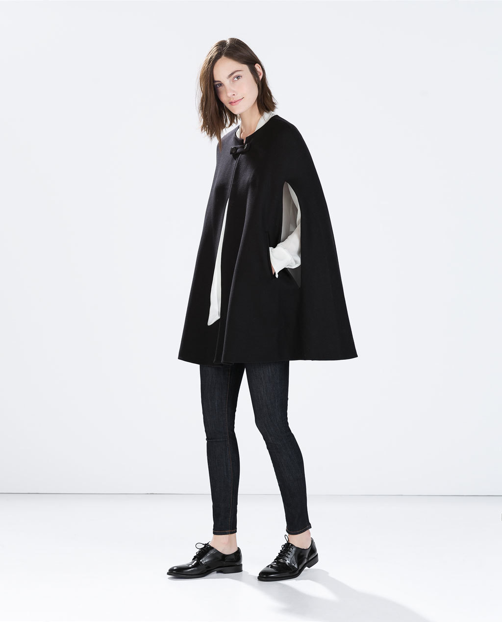 Buttoned Cape Coat - pattern: plain; collar: round collar/collarless; fit: loose; style: cape; length: mid thigh; predominant colour: black; occasions: casual, evening, creative work; fibres: wool - mix; sleeve length: 3/4 length; collar break: high; texture group: woven bulky/heavy; sleeve style: cape/poncho sleeve; trends: outerwear chic; season: a/w 2014