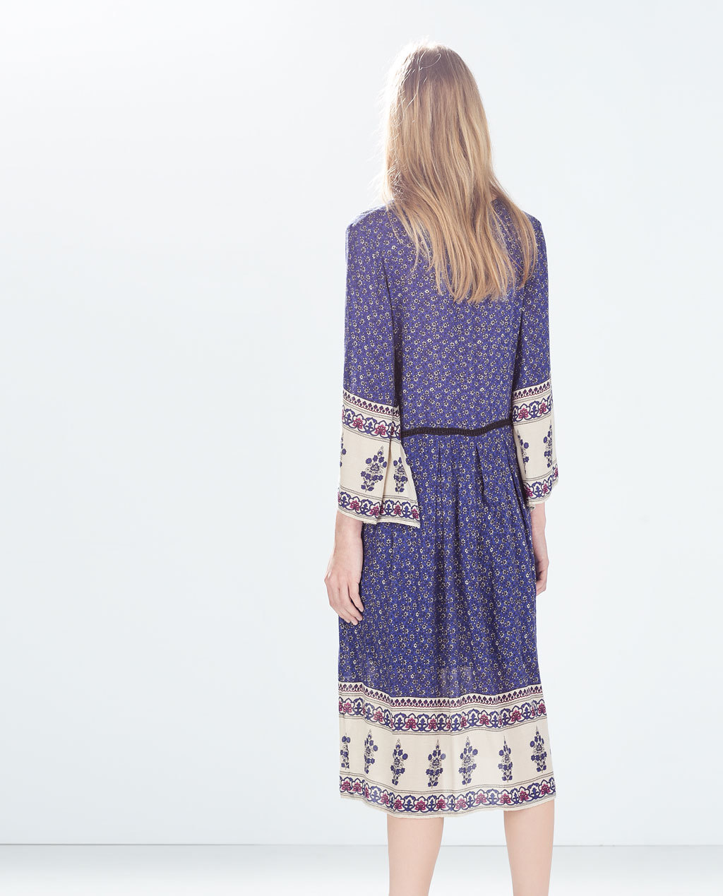 Printed Dress - style: shift; neckline: low v-neck; fit: fitted at waist; predominant colour: navy; occasions: casual, creative work; length: on the knee; fibres: cotton - 100%; sleeve length: long sleeve; sleeve style: standard; pattern type: fabric; pattern size: standard; pattern: patterned/print; texture group: other - light to midweight; season: a/w 2014