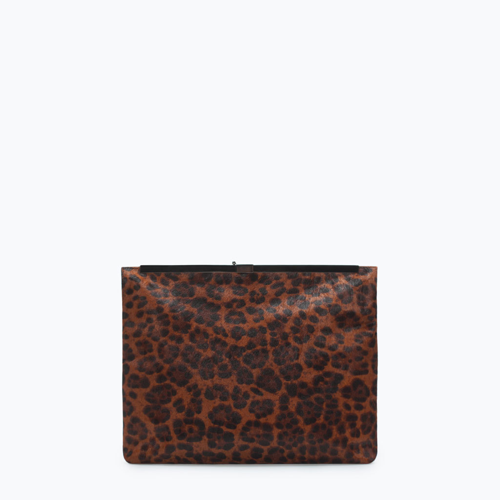 Printed Leather Clutch - predominant colour: tan; secondary colour: black; occasions: casual, evening, occasion, creative work; type of pattern: large; style: clutch; length: hand carry; size: small; material: leather; pattern: animal print; finish: plain; season: a/w 2014