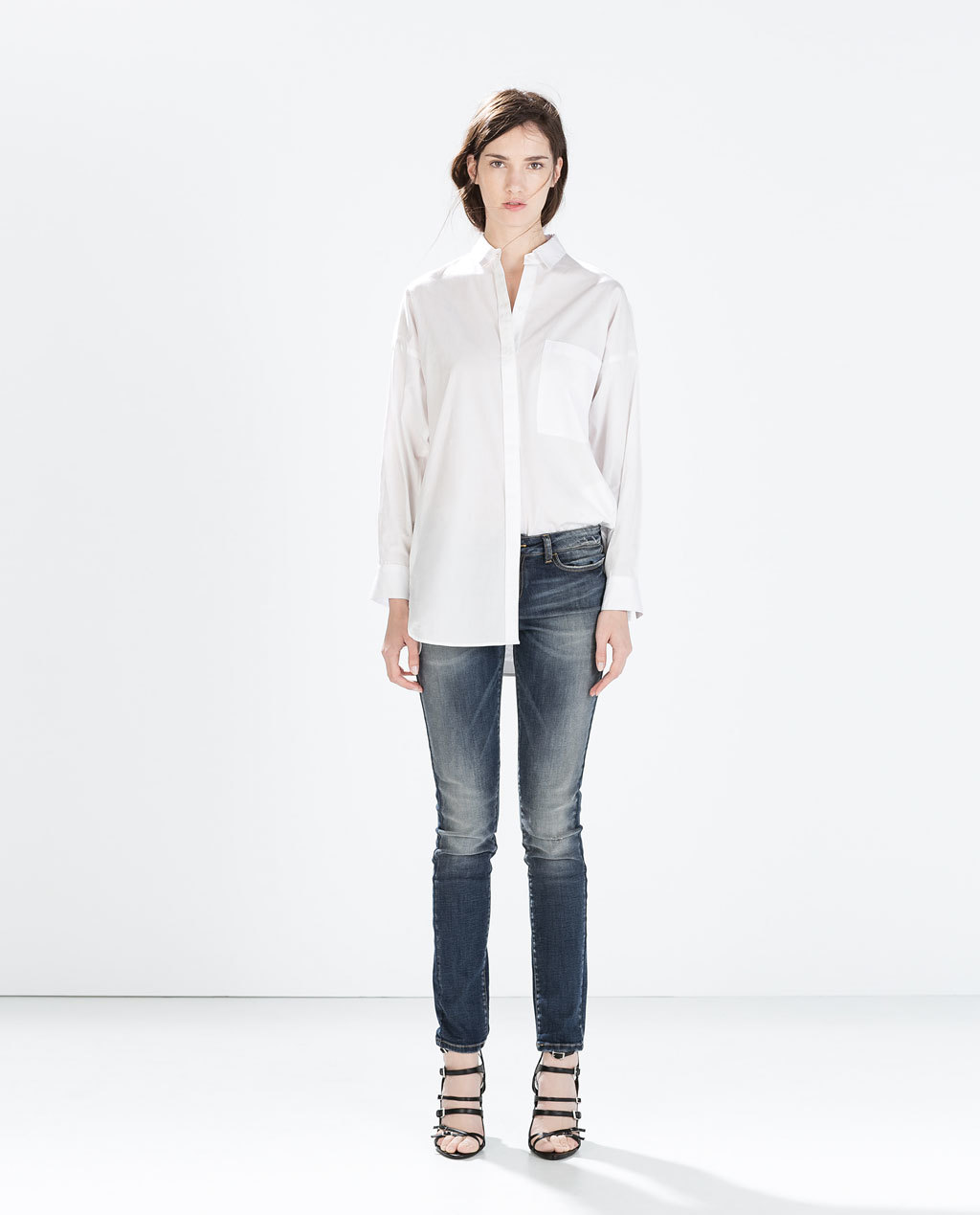 Mid Rise Skinny Jeans - style: skinny leg; length: standard; pattern: plain; pocket detail: traditional 5 pocket; waist: mid/regular rise; predominant colour: navy; occasions: casual, evening; fibres: cotton - stretch; jeans detail: shading down centre of thigh; texture group: denim; pattern type: fabric; season: a/w 2014