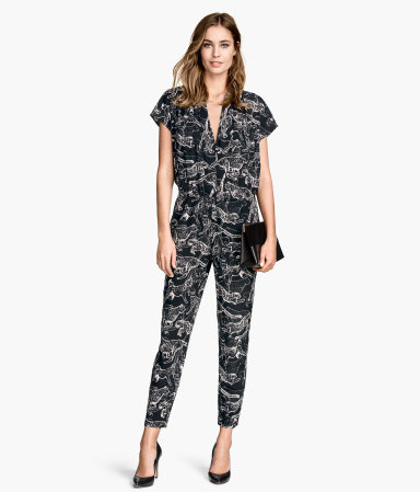 Patterned Jumpsuit - neckline: v-neck; secondary colour: ivory/cream; predominant colour: black; occasions: evening; length: ankle length; fit: body skimming; fibres: polyester/polyamide - 100%; sleeve length: short sleeve; sleeve style: standard; style: jumpsuit; pattern type: fabric; pattern size: standard; pattern: patterned/print; texture group: other - light to midweight; season: s/s 2015; wardrobe: event