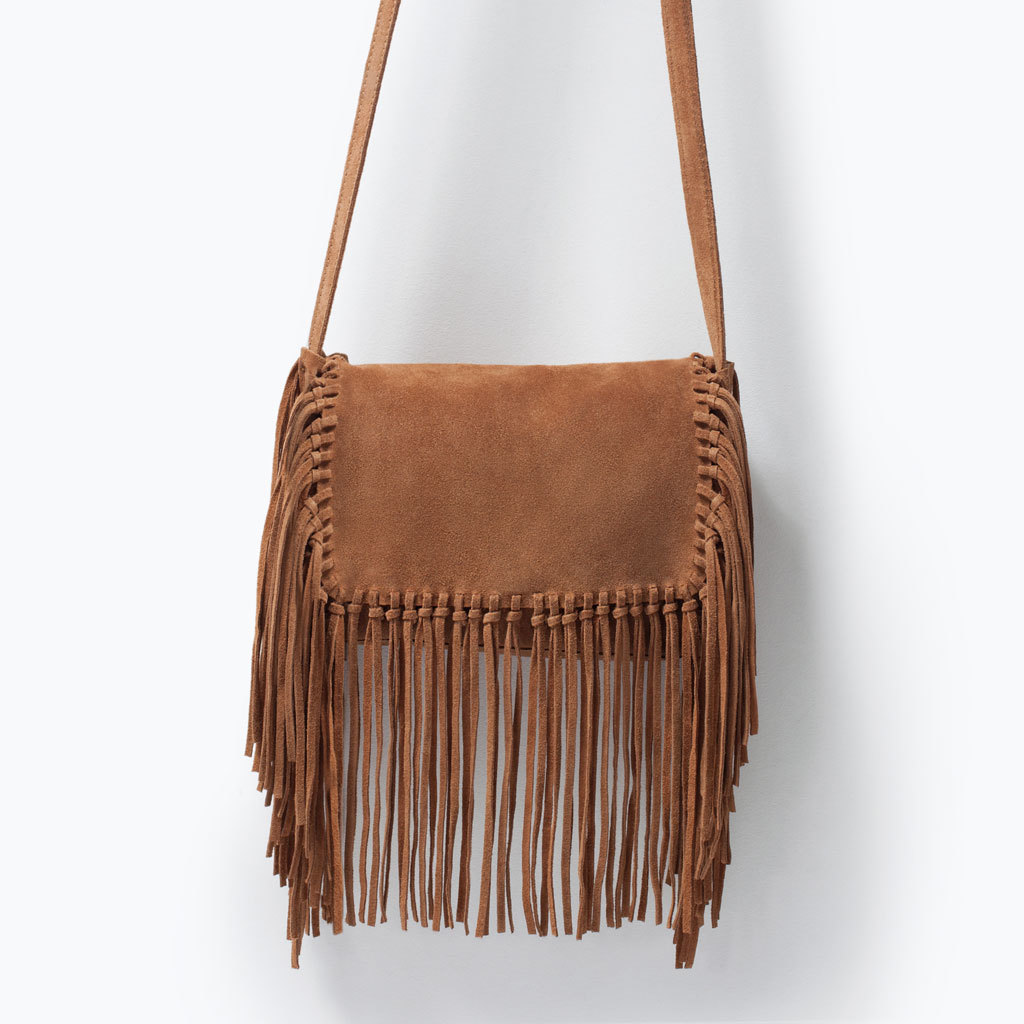 Leather Messenger Bag With Fringing - predominant colour: tan; occasions: casual, creative work; style: messenger; length: across body/long; size: standard; embellishment: tassels; pattern: plain; finish: plain; material: faux suede; season: s/s 2015; wardrobe: highlight