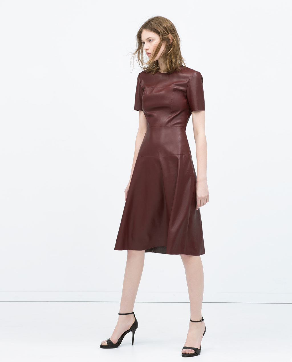 Leather Effect Layered Skirt Dress - length: below the knee; pattern: plain; predominant colour: burgundy; occasions: evening, creative work; fit: fitted at waist & bust; style: fit & flare; fibres: leather - 100%; neckline: crew; sleeve length: short sleeve; sleeve style: standard; texture group: leather; pattern type: fabric; season: s/s 2015; wardrobe: highlight
