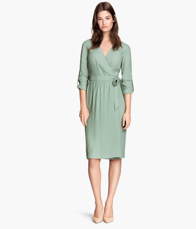 Wrap Dress - style: faux wrap/wrap; neckline: low v-neck; fit: fitted at waist; pattern: plain; waist detail: belted waist/tie at waist/drawstring; predominant colour: pistachio; occasions: casual, occasion, creative work; length: on the knee; fibres: viscose/rayon - 100%; sleeve length: 3/4 length; sleeve style: standard; texture group: woven light midweight; season: s/s 2015; wardrobe: highlight