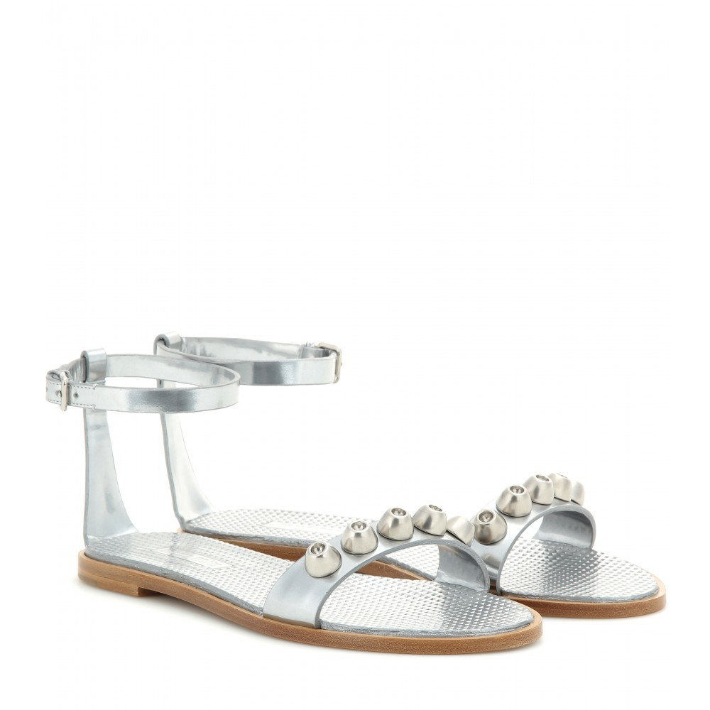 Embellished Metallic Leather Sandals - predominant colour: silver; occasions: casual, holiday; material: leather; heel height: flat; embellishment: studs; ankle detail: ankle strap; heel: standard; toe: open toe/peeptoe; style: standard; finish: metallic; pattern: plain; season: s/s 2015; wardrobe: highlight