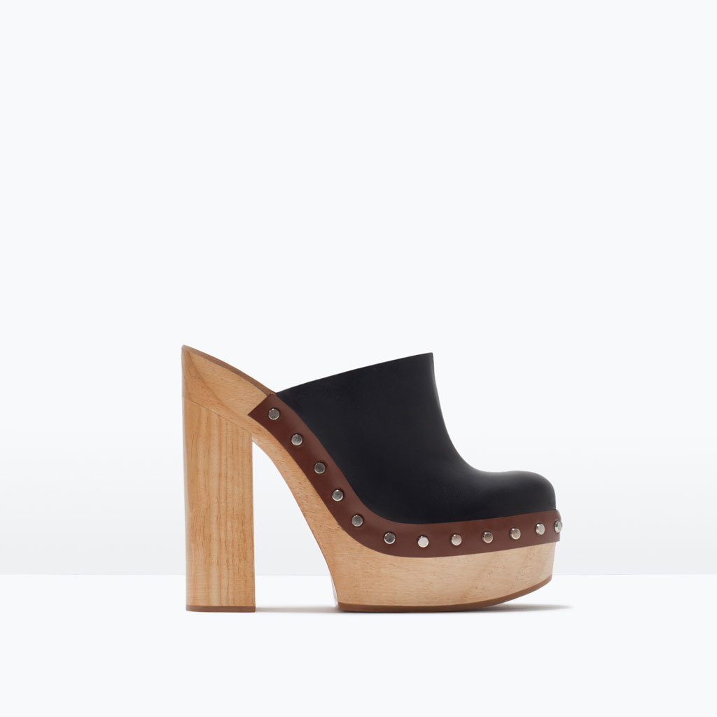 Leather Clogs - predominant colour: black; material: leather; embellishment: studs; heel: block; toe: round toe; style: mules; finish: plain; pattern: colourblock; heel height: very high; occasions: creative work; shoe detail: platform; season: s/s 2015; wardrobe: highlight