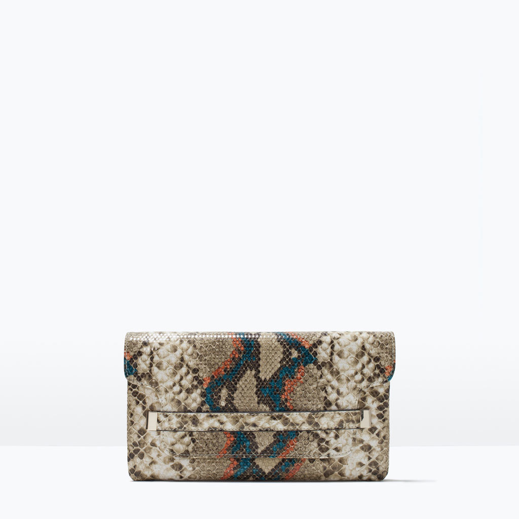 Embossed Clutch - predominant colour: ivory/cream; secondary colour: chocolate brown; occasions: evening, occasion, creative work; type of pattern: standard; style: clutch; length: hand carry; size: standard; material: faux leather; pattern: animal print; finish: plain; season: s/s 2015; wardrobe: highlight