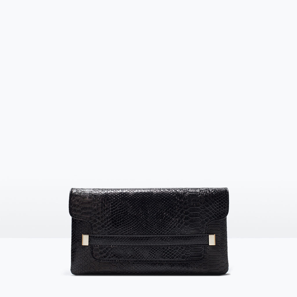Embossed Clutch - predominant colour: black; occasions: evening, occasion; style: clutch; length: hand carry; size: standard; material: faux leather; pattern: plain; finish: plain; season: s/s 2015; wardrobe: event