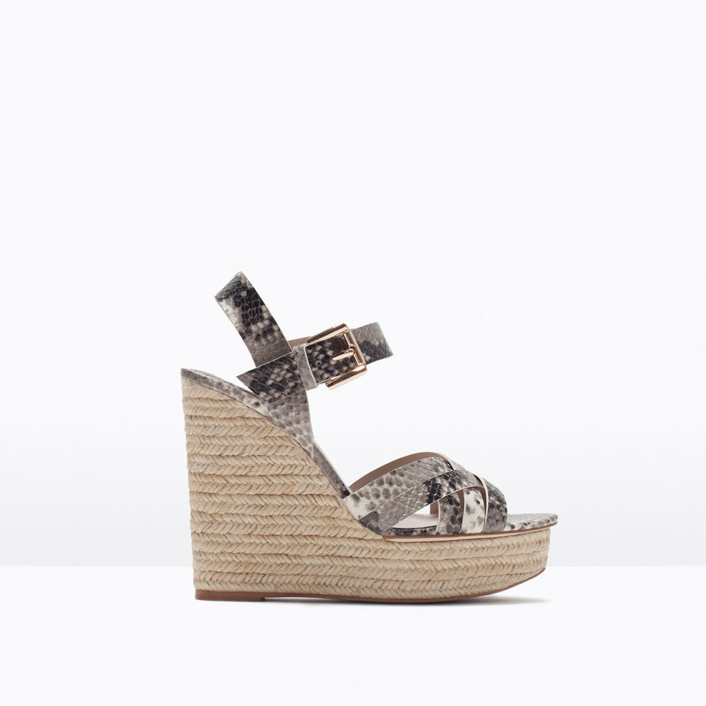 Printed Wedges - predominant colour: stone; occasions: casual, holiday; material: faux leather; ankle detail: ankle strap; heel: wedge; toe: open toe/peeptoe; style: strappy; finish: plain; pattern: animal print; heel height: very high; shoe detail: platform; season: s/s 2015