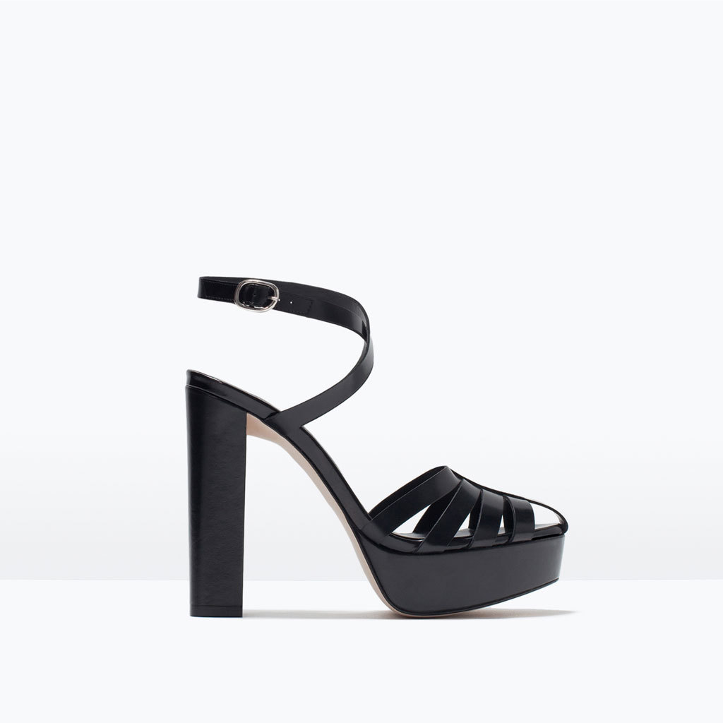 Leather Platform Sandals - predominant colour: black; occasions: evening; material: leather; ankle detail: ankle strap; heel: block; style: gladiators; finish: plain; pattern: plain; heel height: very high; toe: caged; shoe detail: platform; season: s/s 2015; wardrobe: event