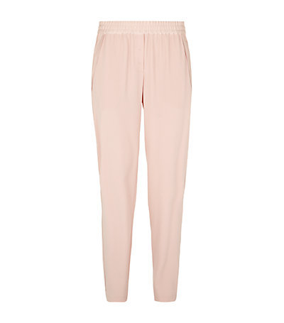 Crepe Tapered Trousers - pattern: plain; waist detail: elasticated waist; style: peg leg; waist: high rise; predominant colour: blush; occasions: evening, creative work; length: ankle length; fibres: polyester/polyamide - mix; hip detail: subtle/flattering hip detail; texture group: crepes; fit: tapered; pattern type: fabric; season: s/s 2015; wardrobe: basic