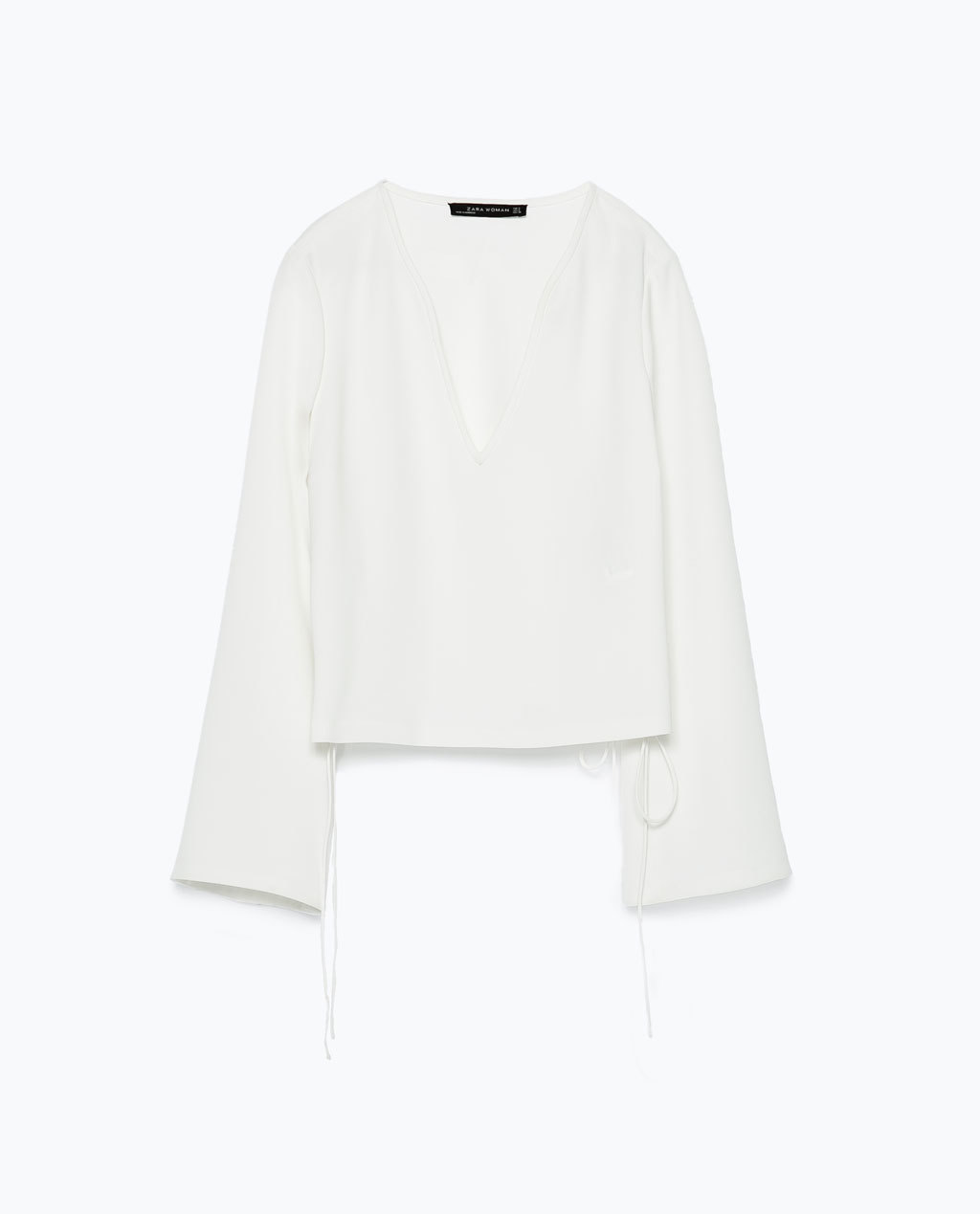 Top - neckline: low v-neck; pattern: plain; predominant colour: ivory/cream; occasions: casual, creative work; length: standard; style: top; fibres: polyester/polyamide - 100%; fit: straight cut; sleeve length: long sleeve; sleeve style: standard; pattern type: fabric; texture group: other - light to midweight; season: s/s 2015; wardrobe: basic