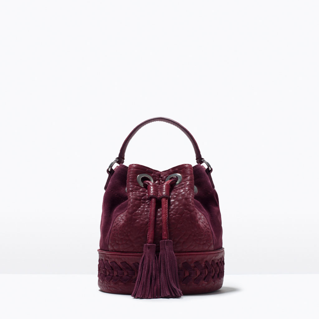 Woven Leather Drawstring Bag - predominant colour: burgundy; occasions: casual, creative work; style: onion bag; length: shoulder (tucks under arm); size: standard; material: leather; embellishment: tassels; pattern: plain; finish: plain; season: s/s 2015; wardrobe: highlight
