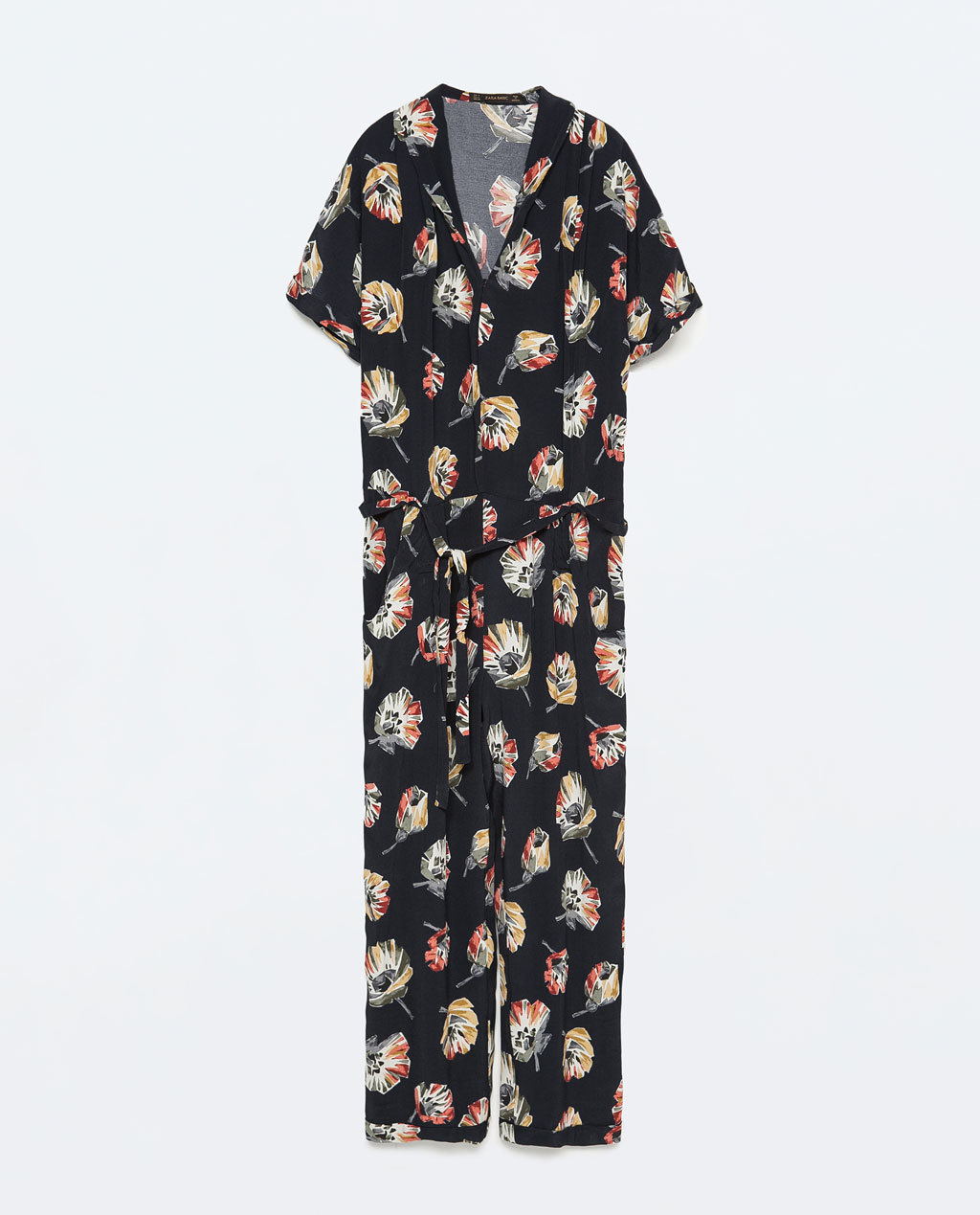 Floral Jumpsuit With Lapel Collar - length: standard; neckline: v-neck; secondary colour: stone; predominant colour: black; occasions: casual; fit: body skimming; fibres: polyester/polyamide - 100%; sleeve length: short sleeve; sleeve style: standard; style: jumpsuit; pattern type: fabric; pattern size: standard; pattern: florals; texture group: other - light to midweight; season: s/s 2015; wardrobe: highlight