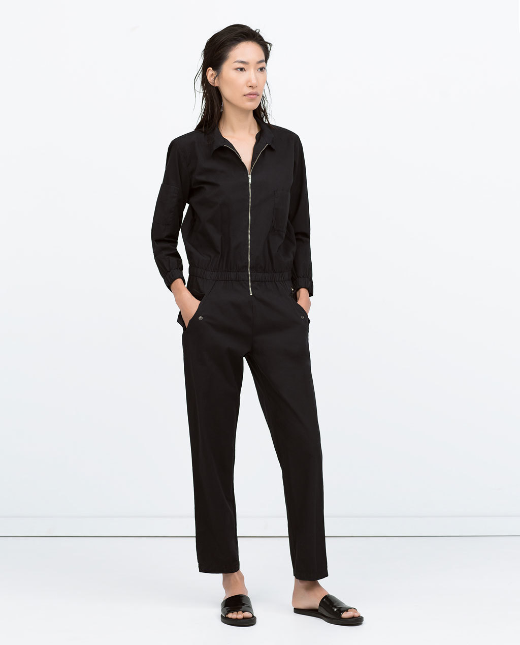 Zipped Poplin Jumpsuit - length: standard; neckline: v-neck; pattern: plain; predominant colour: black; occasions: casual, evening; fit: body skimming; fibres: cotton - 100%; sleeve length: long sleeve; sleeve style: standard; texture group: cotton feel fabrics; style: jumpsuit; season: s/s 2015