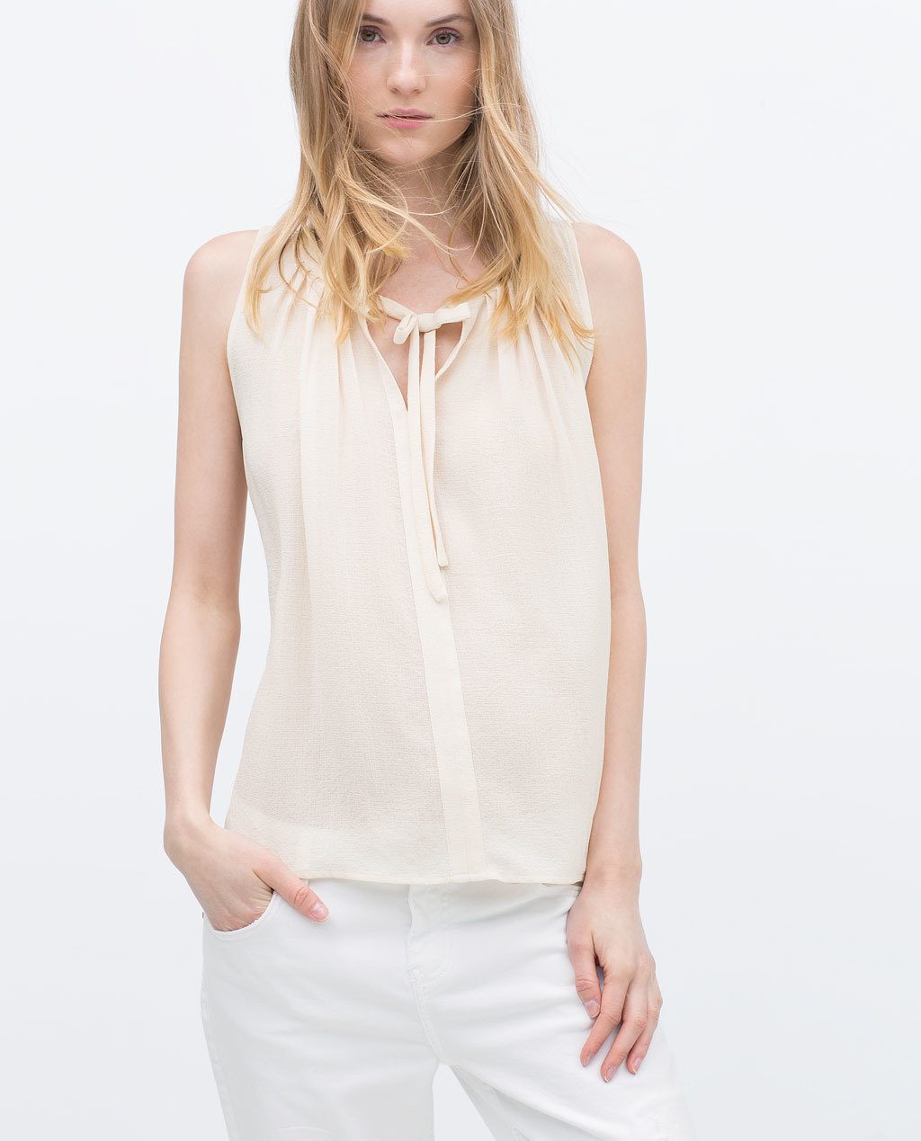 Pleated Full Top - pattern: plain; sleeve style: sleeveless; neckline: pussy bow; style: blouse; predominant colour: ivory/cream; occasions: casual, creative work; length: standard; fibres: polyester/polyamide - 100%; fit: straight cut; sleeve length: sleeveless; texture group: sheer fabrics/chiffon/organza etc.; pattern type: fabric; season: s/s 2015; wardrobe: highlight