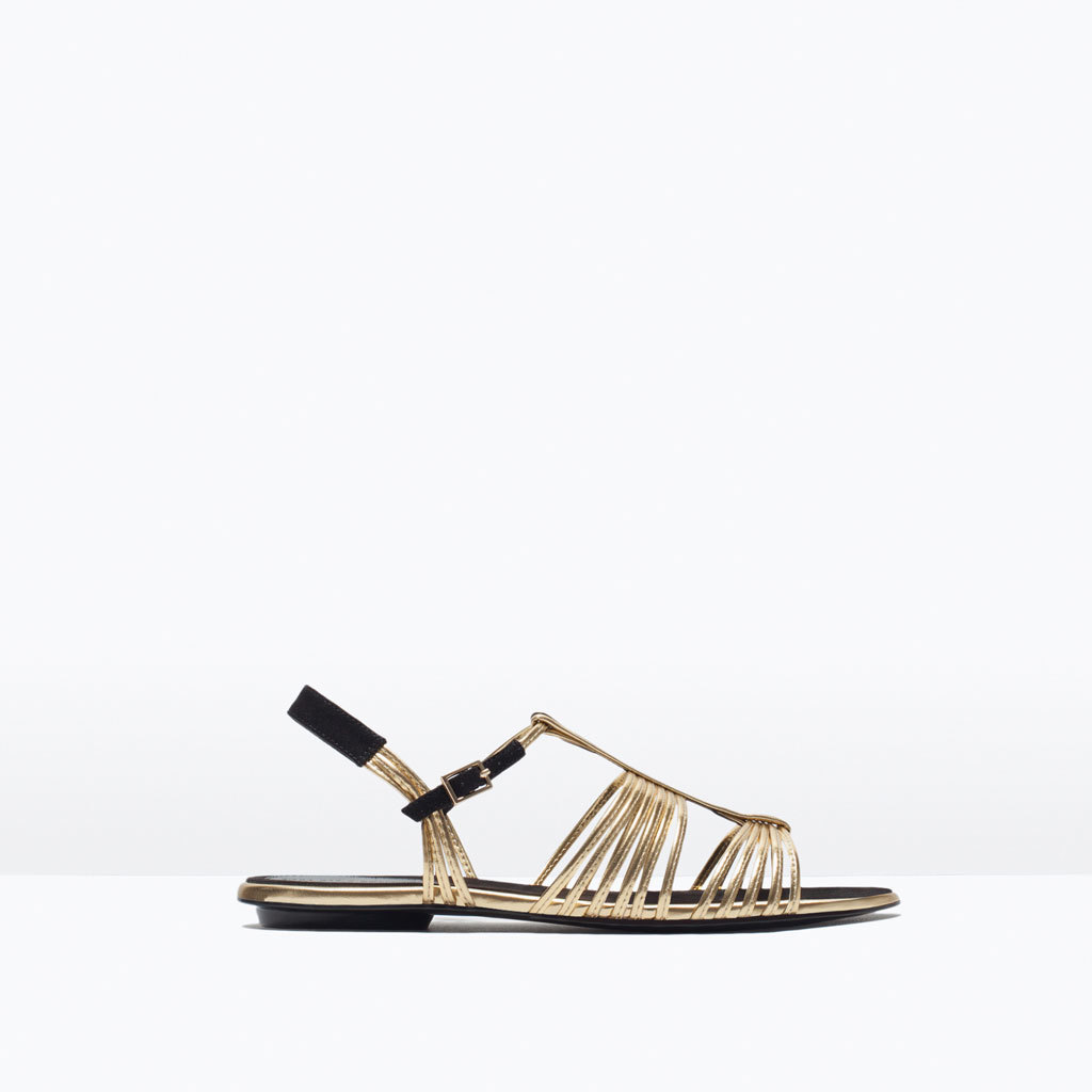 Flat Strappy Sandal - predominant colour: gold; secondary colour: black; occasions: casual, holiday; material: leather; heel height: flat; ankle detail: ankle strap; heel: standard; toe: open toe/peeptoe; style: strappy; finish: metallic; pattern: colourblock; season: s/s 2015; wardrobe: highlight