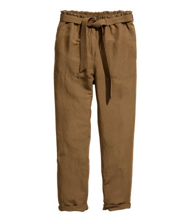 Trousers In A Linen Blend - pattern: plain; style: peg leg; waist: high rise; pocket detail: pockets at the sides; waist detail: belted waist/tie at waist/drawstring; predominant colour: tan; occasions: casual; length: ankle length; fibres: linen - mix; jeans & bottoms detail: turn ups; texture group: linen; fit: tapered; pattern type: fabric; season: s/s 2015; wardrobe: highlight