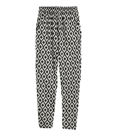 Patterned Jersey Trousers - length: standard; waist detail: elasticated waist; style: peg leg; waist: high rise; secondary colour: white; predominant colour: black; occasions: casual, creative work; fibres: viscose/rayon - 100%; fit: tapered; pattern type: fabric; pattern: patterned/print; texture group: jersey - stretchy/drapey; season: s/s 2015; pattern size: standard (bottom)