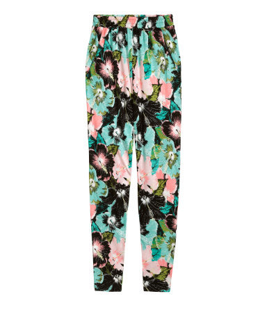 Patterned Jersey Trousers - length: standard; waist detail: elasticated waist; style: peg leg; waist: high rise; secondary colour: turquoise; predominant colour: black; occasions: casual; fibres: viscose/rayon - 100%; fit: tapered; pattern type: fabric; pattern: florals; texture group: jersey - stretchy/drapey; season: s/s 2015; pattern size: big & busy (bottom); multicoloured: multicoloured