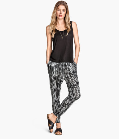Patterned Jersey Trousers - length: standard; style: peg leg; waist: mid/regular rise; predominant colour: black; occasions: casual; fit: tapered; pattern type: fabric; pattern: patterned/print; texture group: jersey - stretchy/drapey; season: s/s 2015; pattern size: standard (bottom); wardrobe: highlight