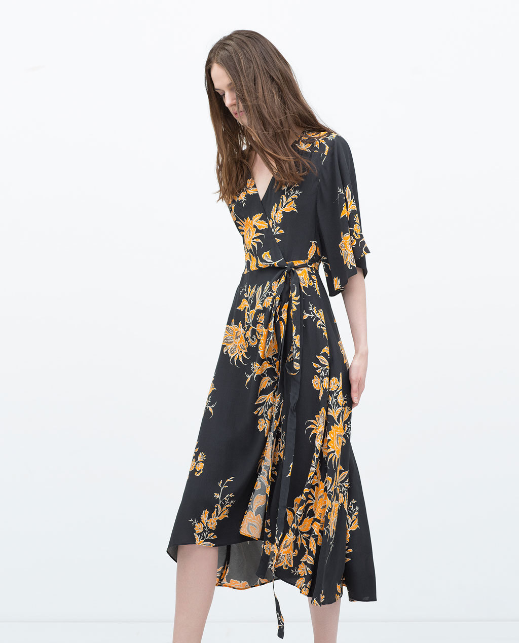 Printed Dress - style: faux wrap/wrap; length: below the knee; neckline: low v-neck; sleeve style: angel/waterfall; waist detail: belted waist/tie at waist/drawstring; secondary colour: bright orange; predominant colour: black; occasions: casual, occasion; fit: fitted at waist & bust; fibres: viscose/rayon - 100%; hip detail: subtle/flattering hip detail; sleeve length: 3/4 length; texture group: sheer fabrics/chiffon/organza etc.; pattern type: fabric; pattern size: standard; pattern: florals; season: s/s 2015; multicoloured: multicoloured; wardrobe: highlight
