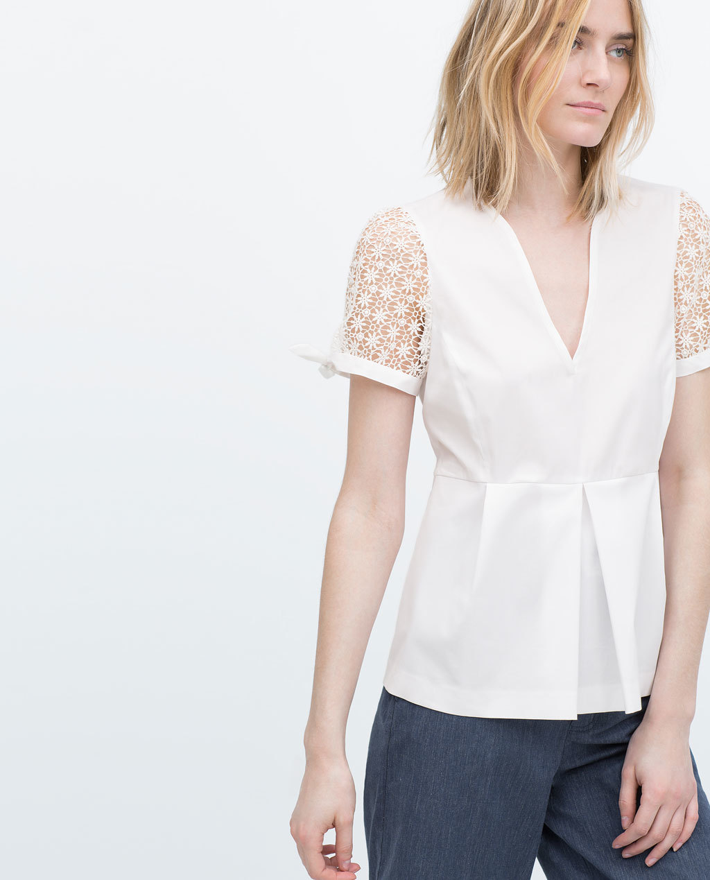 Guipure Lace Poplin Peplum Top - neckline: v-neck; pattern: plain; waist detail: peplum waist detail; predominant colour: white; occasions: casual, work, occasion; length: standard; style: top; fibres: cotton - stretch; fit: tailored/fitted; sleeve length: short sleeve; sleeve style: standard; texture group: cotton feel fabrics; pattern type: fabric; embellishment: lace; season: s/s 2015