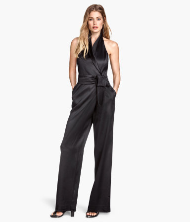 Jumpsuit In A Lyocell Blend - fit: fitted at waist; pattern: plain; sleeve style: sleeveless; neckline: low halter neck; waist detail: belted waist/tie at waist/drawstring; length: short shorts; predominant colour: black; occasions: evening, occasion; fibres: viscose/rayon - 100%; sleeve length: sleeveless; texture group: structured shiny - satin/tafetta/silk etc.; style: jumpsuit; pattern type: fabric; season: s/s 2015; wardrobe: event