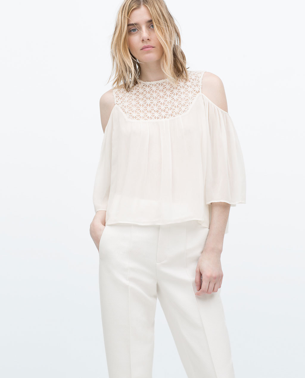 Guipure Lace Off Shoulder Blouse - sleeve style: angel/waterfall; pattern: plain; style: blouse; predominant colour: ivory/cream; occasions: casual, evening, occasion, creative work; length: standard; fibres: viscose/rayon - 100%; fit: straight cut; neckline: crew; shoulder detail: cut out shoulder; sleeve length: 3/4 length; texture group: sheer fabrics/chiffon/organza etc.; pattern type: fabric; season: s/s 2015