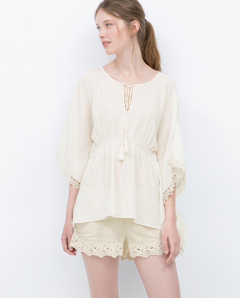 Combined Crochet Tunic - sleeve style: angel/waterfall; pattern: plain; length: below the bottom; style: tunic; predominant colour: ivory/cream; occasions: casual; neckline: peep hole neckline; fibres: polyester/polyamide - 100%; fit: loose; sleeve length: 3/4 length; texture group: cotton feel fabrics; pattern type: fabric; season: s/s 2015; wardrobe: basic