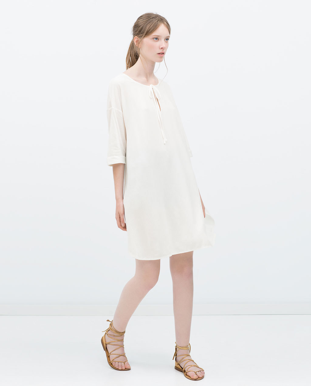 Combined Kaftan T Shirt - neckline: round neck; fit: loose; pattern: plain; style: kaftan; predominant colour: ivory/cream; length: just above the knee; sleeve length: 3/4 length; sleeve style: standard; texture group: sheer fabrics/chiffon/organza etc.; occasions: holiday; pattern type: fabric; fibres: viscose/rayon - mix; season: s/s 2015; wardrobe: holiday
