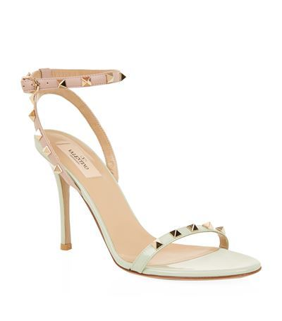 Rockstud 100 Patent Sandal - predominant colour: white; secondary colour: gold; occasions: evening, occasion; material: leather; heel height: high; embellishment: studs; heel: stiletto; toe: open toe/peeptoe; style: strappy; finish: plain; pattern: plain; season: s/s 2015