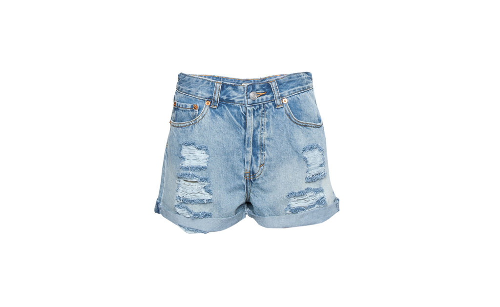 Ripped Denim Shorts - pattern: plain; waist: high rise; pocket detail: traditional 5 pocket; predominant colour: pale blue; occasions: casual, holiday; fibres: cotton - 100%; texture group: denim; pattern type: fabric; season: s/s 2015; style: denim; length: short shorts; fit: slim leg