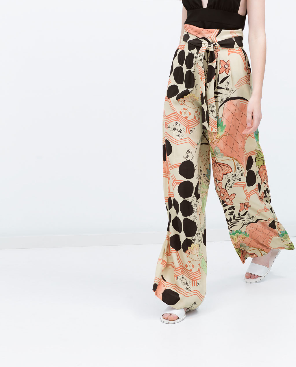 Printed Loose Fit Trousers - length: standard; style: palazzo; waist: high rise; pocket detail: pockets at the sides; waist detail: belted waist/tie at waist/drawstring; secondary colour: terracotta; predominant colour: black; occasions: casual, evening, creative work; fibres: viscose/rayon - 100%; fit: wide leg; pattern type: fabric; pattern: patterned/print; texture group: woven light midweight; season: s/s 2015; wardrobe: highlight
