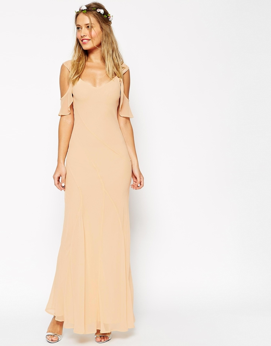 Wedding Bias Cut Maxi Dress With Seams And Frill Sleeves Cream - pattern: plain; style: maxi dress; length: ankle length; predominant colour: nude; occasions: evening; fit: body skimming; neckline: scoop; fibres: polyester/polyamide - 100%; hip detail: subtle/flattering hip detail; shoulder detail: cut out shoulder; sleeve length: short sleeve; sleeve style: standard; texture group: sheer fabrics/chiffon/organza etc.; pattern type: fabric; season: s/s 2015; wardrobe: event