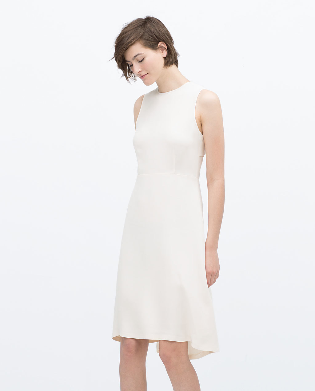 Mid Length Flounce Dress With Open Back - style: shift; pattern: plain; sleeve style: sleeveless; predominant colour: ivory/cream; length: just above the knee; fit: soft a-line; fibres: viscose/rayon - 100%; occasions: occasion, creative work; neckline: crew; back detail: longer hem at back than at front; sleeve length: sleeveless; pattern type: fabric; texture group: other - light to midweight; season: s/s 2015; wardrobe: investment