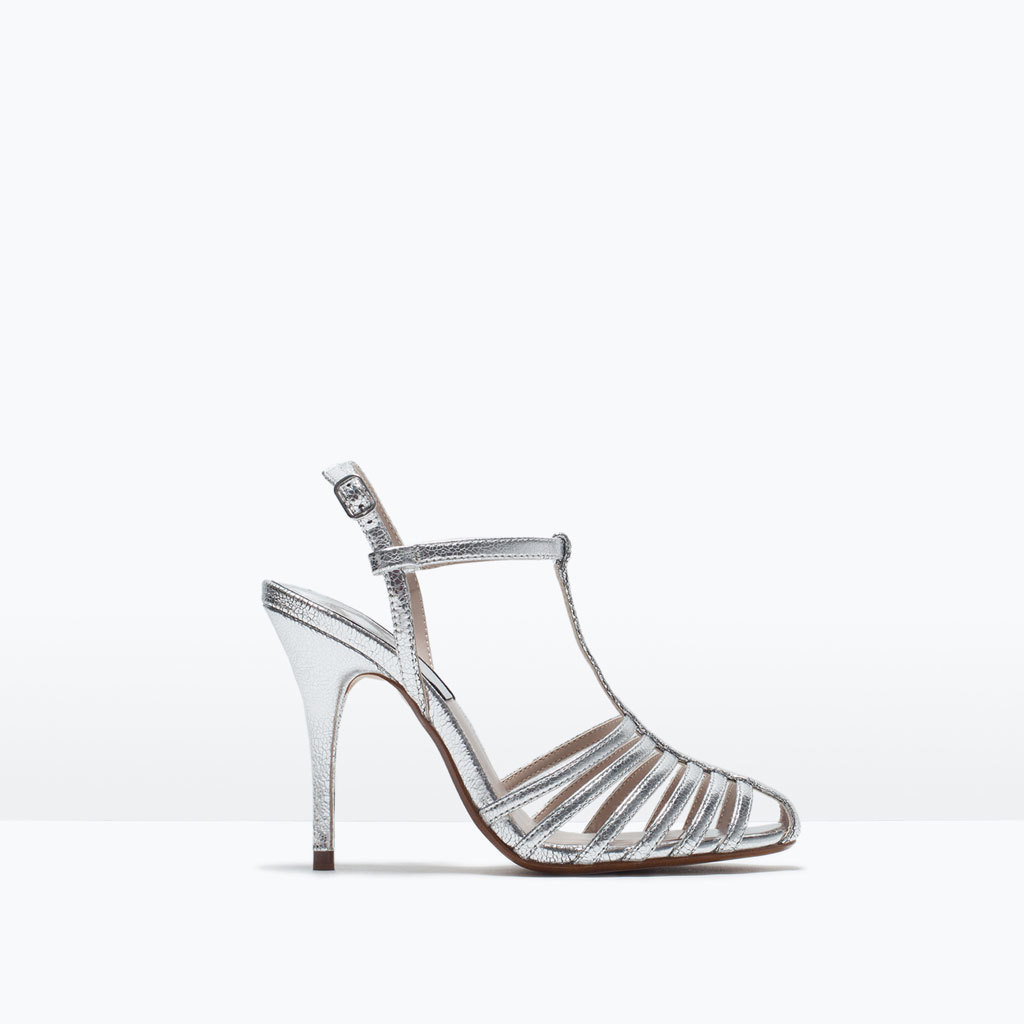 High Heel T Bar Shoes - predominant colour: silver; occasions: evening, occasion; material: faux leather; heel height: high; heel: stiletto; style: strappy; finish: metallic; pattern: plain; toe: caged; season: s/s 2015; wardrobe: event