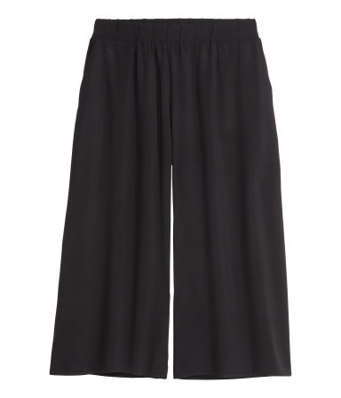 + Culottes - pattern: plain; waist detail: elasticated waist; waist: high rise; predominant colour: black; occasions: casual, creative work; fibres: viscose/rayon - 100%; pattern type: fabric; texture group: jersey - stretchy/drapey; season: s/s 2015; wardrobe: basic; style: culotte; length: below the knee; fit: a-line