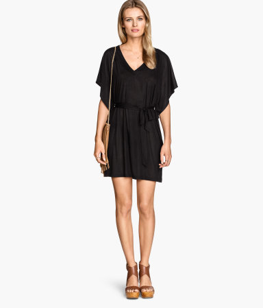 Beach Dress - length: mid thigh; neckline: low v-neck; sleeve style: angel/waterfall; fit: fitted at waist; pattern: plain; style: sundress; waist detail: belted waist/tie at waist/drawstring; predominant colour: black; occasions: casual, holiday; fibres: polyester/polyamide - mix; sleeve length: half sleeve; pattern type: fabric; texture group: jersey - stretchy/drapey; season: s/s 2015; wardrobe: basic