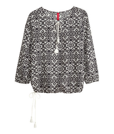 Tunic - style: tunic; sleeve style: balloon; secondary colour: white; predominant colour: black; occasions: casual; length: standard; neckline: peep hole neckline; fibres: viscose/rayon - 100%; fit: loose; sleeve length: 3/4 length; pattern type: fabric; pattern: patterned/print; texture group: woven light midweight; season: s/s 2015; multicoloured: multicoloured; wardrobe: highlight