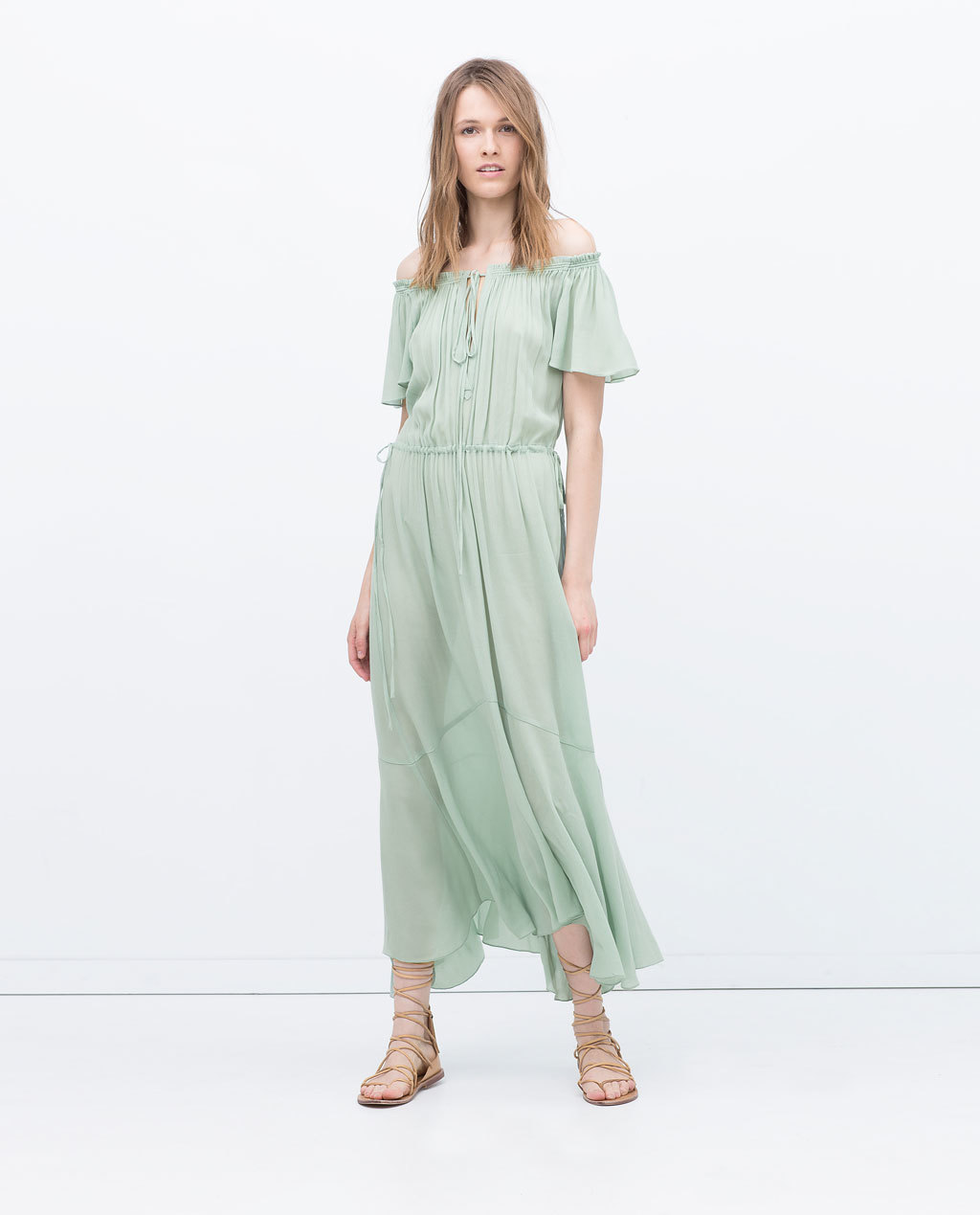 Long Studio Dress - neckline: off the shoulder; sleeve style: angel/waterfall; pattern: plain; style: maxi dress; length: ankle length; predominant colour: pistachio; occasions: casual; fit: soft a-line; fibres: polyester/polyamide - 100%; hip detail: subtle/flattering hip detail; sleeve length: short sleeve; texture group: sheer fabrics/chiffon/organza etc.; pattern type: fabric; season: s/s 2015; wardrobe: highlight