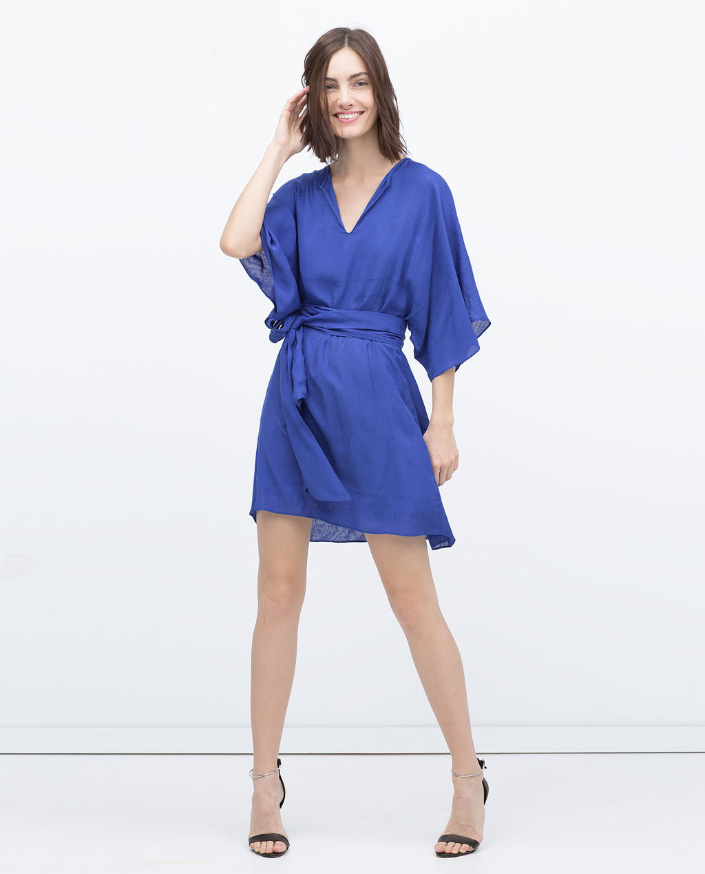 Jacquard Viscose Dress - length: mid thigh; neckline: v-neck; sleeve style: angel/waterfall; fit: fitted at waist; pattern: plain; style: blouson; waist detail: belted waist/tie at waist/drawstring; predominant colour: royal blue; occasions: evening, occasion; fibres: viscose/rayon - 100%; hip detail: subtle/flattering hip detail; sleeve length: 3/4 length; pattern type: fabric; texture group: brocade/jacquard; season: s/s 2015; wardrobe: event