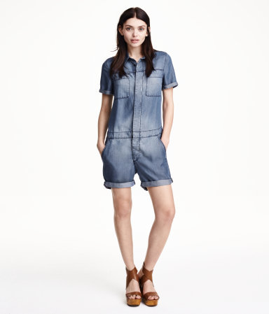 Denim Playsuit - neckline: shirt collar/peter pan/zip with opening; pattern: plain; length: mid thigh shorts; predominant colour: denim; occasions: casual; fit: straight cut; fibres: cotton - 100%; jeans & bottoms detail: turn ups; sleeve length: short sleeve; sleeve style: standard; texture group: denim; style: playsuit; pattern type: fabric; trends: alternative denim; season: s/s 2015; wardrobe: highlight
