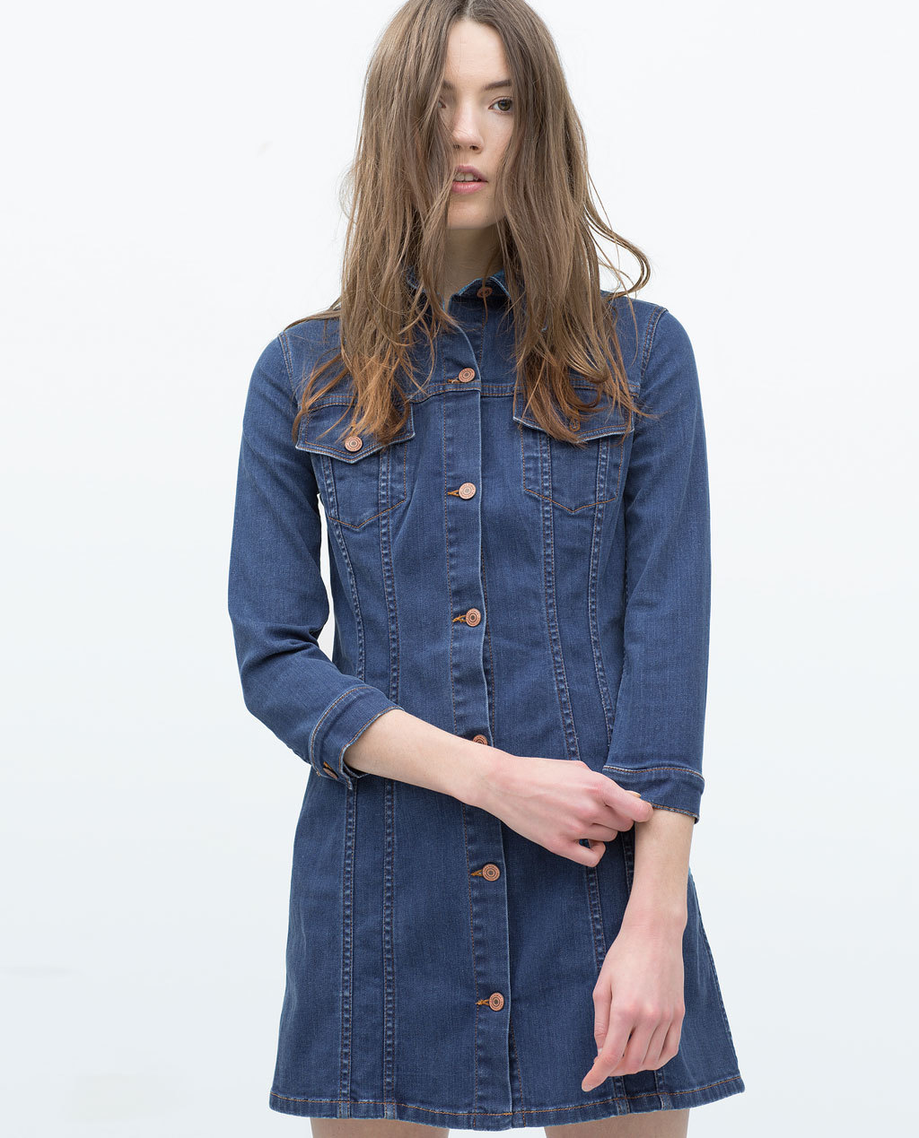 Denim Dress - style: shirt; length: mini; neckline: shirt collar/peter pan/zip with opening; pattern: plain; bust detail: subtle bust detail; predominant colour: denim; occasions: casual, creative work; fit: soft a-line; fibres: cotton - stretch; sleeve length: 3/4 length; sleeve style: standard; texture group: denim; pattern type: fabric; season: s/s 2015; wardrobe: basic