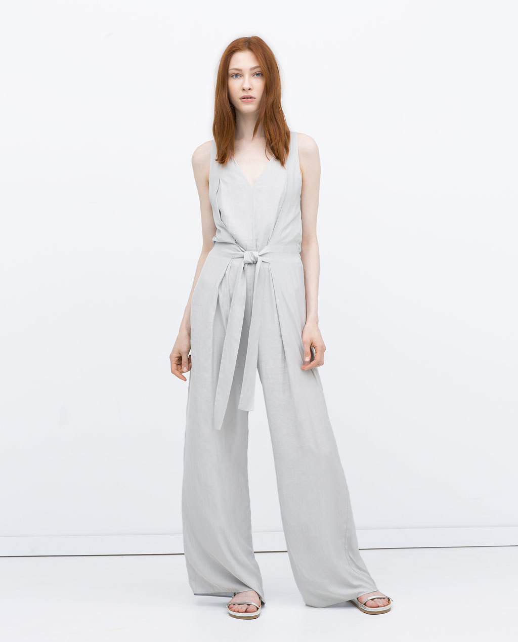 Jumpsuit Dress With Tie Waist - length: standard; neckline: v-neck; fit: fitted at waist; pattern: plain; sleeve style: sleeveless; waist detail: belted waist/tie at waist/drawstring; predominant colour: light grey; occasions: casual, evening; fibres: polyester/polyamide - 100%; sleeve length: sleeveless; texture group: crepes; style: jumpsuit; pattern type: fabric; season: s/s 2015; wardrobe: highlight