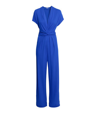 V Neck Jumpsuit - length: standard; neckline: low v-neck; sleeve style: dolman/batwing; fit: fitted at waist; pattern: plain; predominant colour: royal blue; occasions: evening, occasion; fibres: viscose/rayon - 100%; sleeve length: short sleeve; style: jumpsuit; pattern type: fabric; texture group: jersey - stretchy/drapey; season: s/s 2015; wardrobe: event