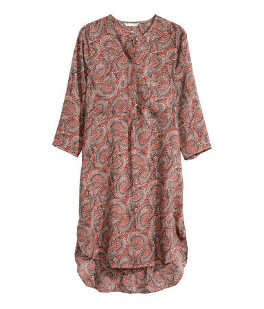 Tunic Dress - style: tunic; length: mid thigh; neckline: v-neck; pattern: paisley; predominant colour: bright orange; secondary colour: black; occasions: casual; fit: straight cut; fibres: viscose/rayon - 100%; sleeve length: 3/4 length; sleeve style: standard; texture group: cotton feel fabrics; pattern type: fabric; pattern size: standard; season: s/s 2015; multicoloured: multicoloured
