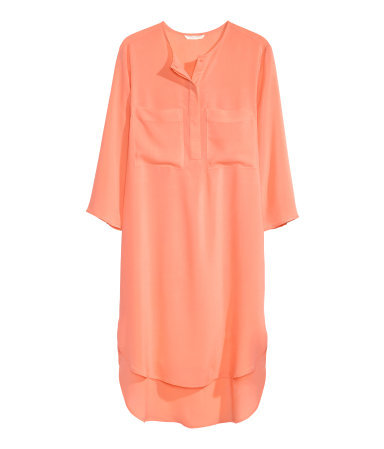 Tunic Dress - style: tunic; neckline: round neck; pattern: plain; bust detail: subtle bust detail; predominant colour: coral; occasions: casual; length: just above the knee; fit: body skimming; fibres: viscose/rayon - 100%; back detail: longer hem at back than at front; sleeve length: 3/4 length; sleeve style: standard; pattern type: fabric; texture group: woven light midweight; season: s/s 2015; wardrobe: highlight