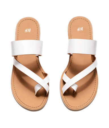 Sandals - predominant colour: white; occasions: casual, holiday; material: faux leather; heel height: flat; heel: standard; toe: open toe/peeptoe; style: flip flops; finish: plain; pattern: plain; season: s/s 2015; wardrobe: highlight